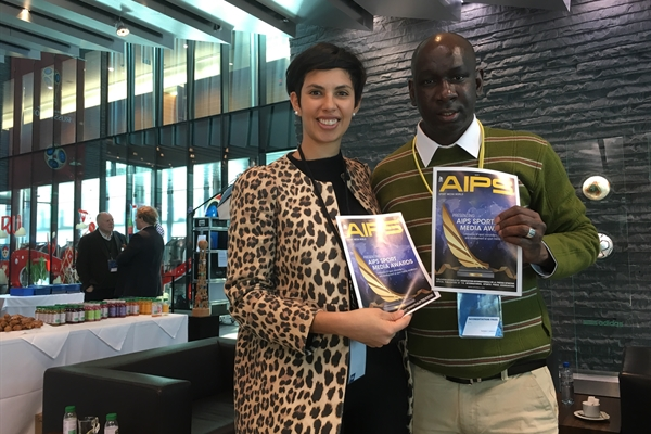 AIPS representative Maria Pia Beltran presenting the AIPS Sport Media Awards magazine edition to Camara Lassana, Mauritaniefootball.com at the FIFA Conference for Equality and Inclusion 2018. FIFA Headquarters, Zurich, March 2, 2018.